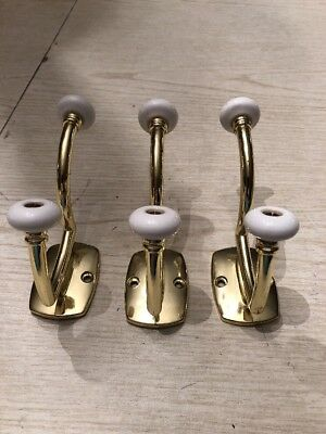 lot of 3 brasstone coat hooks with ceramic detail