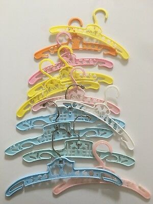 vintage hangers, all childrens. various colors, lot of 12
