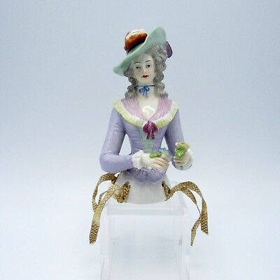 Antique Half Doll Wearing Large Hat, Blue Ribbon at Neck, Holding Flowers