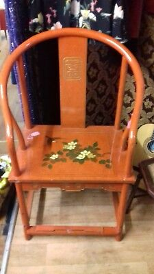 Oriental chair finished in red lacquer