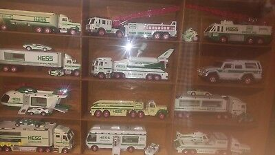 Hess Toy Truck Lot 27 from 1985 to 2016 in display cases with oak and plexiglass