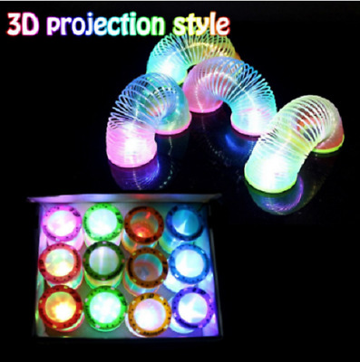 Magical Rainbow Spring Toy Slinky Circle Stretchy Coil Glow in Dark Walking