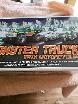 """2007 HESS """"MONSTER TRUCK WITH MOTORCYCLES"""". Never been taken out of box in mint"""