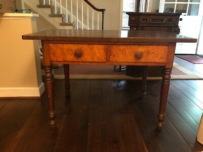 Antique wood desk with beautiful burled wood drawers.
