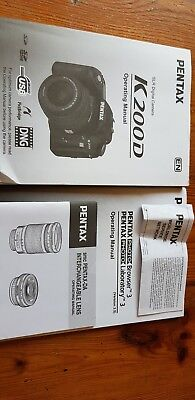 Pentax K200D with 18-55mm lens, bag, books and 4GB SD card