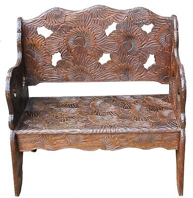 An Early 20th Century Carved Wood Bench