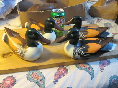 """4 matching 8 3/4"""" long, hand carved & painted wooden ducks. '1988-1993'"""