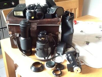 Camera and a selection of lenses and filters. over 40 years old.  Incl case.