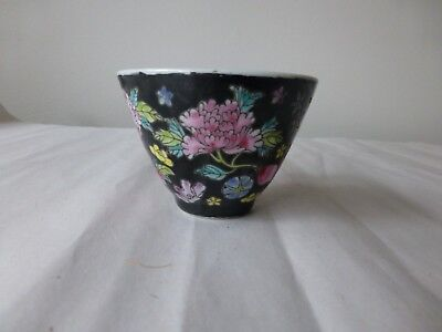 Small famille noire tea cup with marks