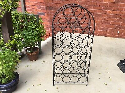 Decorative Metal wine rack. Holds 33 Bottles.