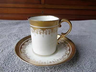 George Jones Crescent china gilt coffee cup and saucer