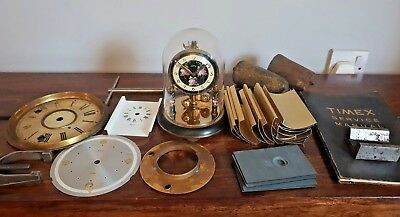 Vintage Koma Anniversary Clock and Box of Clock Parts (Faces Weights Manual)