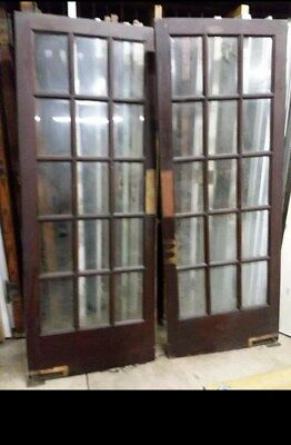 Antique Vintage French Swinging Beveled Glass Doors.