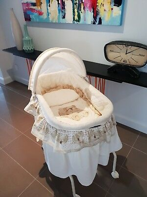 Baby bassinet and stand.Love N Care Design Fold up base. swivel, lockable wheels