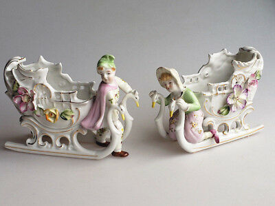 Pair of porcelain swan sleigh figurine planters boy and girl vintage Germany