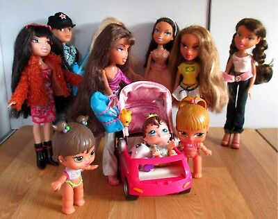 7 Brats Dolls And 3 Babies With Pram, Good Condition Except Boy Has Hair Cut.