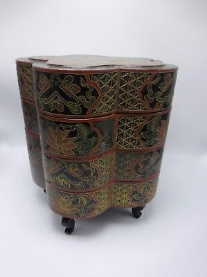 Antique footed black lacquer stacking box with 4 layers in the shape of a flower