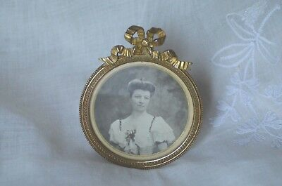 Antique French solid bronze circular photograph frame, ribbon crest