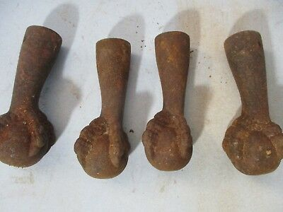Antique Claw Feet Cast Iron Set OF 4 Rusty Claw And Ball table legs.