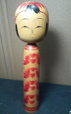 Solid wood vintage,old Japanese Kokeshi doll bout 9.5 x 2.5 .Marked on bottom