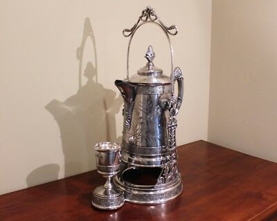 Rare Antique Tilting Ice water Pitcher with quadruple silver plating