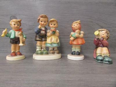 4 Goebel Hummel Figurines All TMK 6 Girl with Doll Boy With Horse Horn Flowers