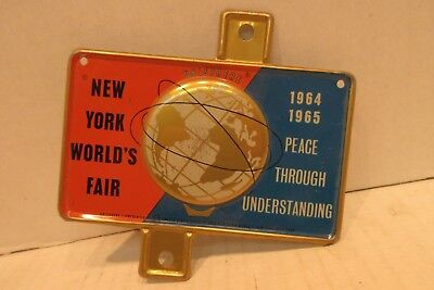 1964/1965 New York Worlds Fair Bicycle License Plate Topper Unisphere U.S. Steel