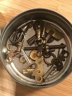 Mixture of odd pocket watch and clock keys & accessories