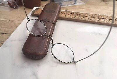 A Pair Of Antique Spectacles In A Vintage Or Antique Tooled Leather Case
