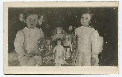 Two Young Girls with Their Dolls RPPC
