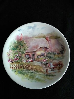 Set of two poole pottery decorative plates