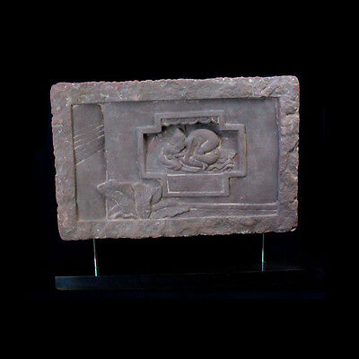 A Ming Dynasty stone panel depicting an erotic scene.x8574