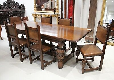 A Very Beautiful Carved Oak Refectory Table And Six Leather Chairs