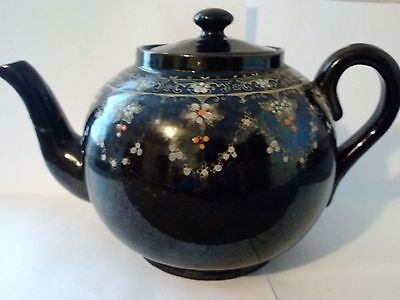 Teapot, Small Ceramic, Dark brown with decorative design, broken spout