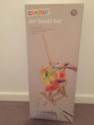 Wooden easel set with canvas and paint and brushes