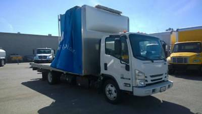 Isuzu NRR Tow truck Rollback flatbed Enclosed Carrier wrecker ftr frr hino ud