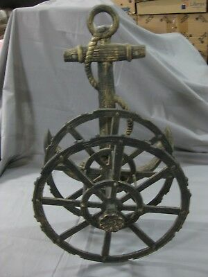Old Support For Water Hose, Manufactured In Cast Iron.form Of Marine Anchor.