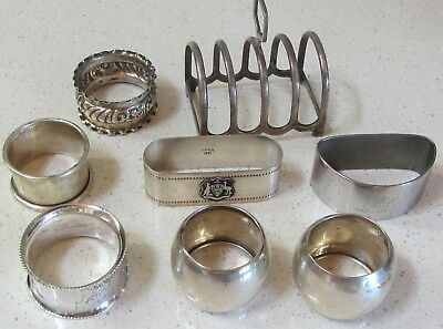 Group of 7 Serviette Rings and a Toast Rack