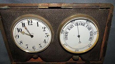 AN EARLY 20th CENTURY CASED TRAVELLING BAROMETER AND CLOCK