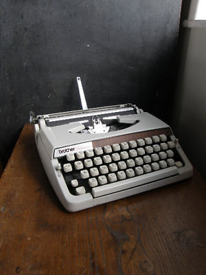 1960s Brother deluxe cream , wood effect, manual typewriter,new ribbon