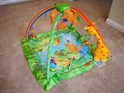 Used Fisher Price Rainforest play mat / baby gym good condition with case