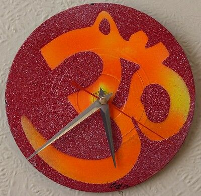 Funky UV wall clocks... tribal.. .spiral,.. .trippy.. .HAWKWIND.. .gong