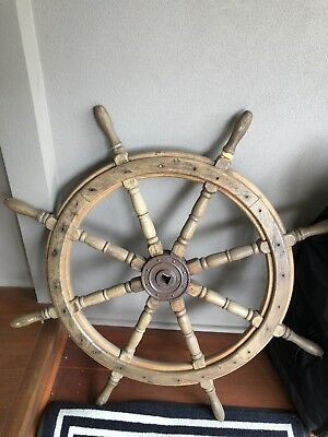 Large wooden Ships steering wheel with brass centre,