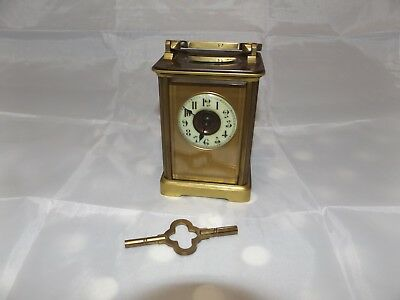 old vintage brass carriage clock with key