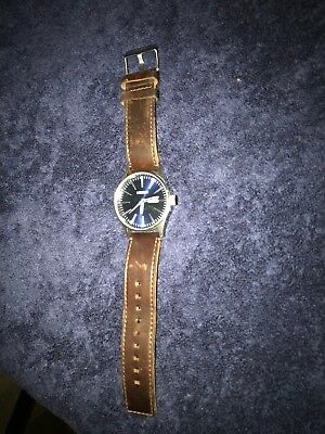 Nixon watch blue face with brown leather band