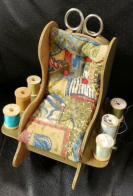 vintage sewing pin cushion rocking chair with thread and sissors