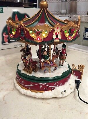 Hawthorne Village - Christmas Cheer Carousel that lights up- plays music