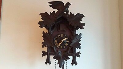 Vintage wooden cuckoo clock from Germany, good condition, works well.