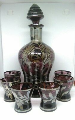 Vintage translucent purple decanter and six shot glasses with floral pattern