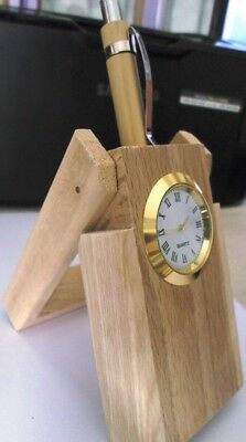 wood pen holder also watch and one pen same wood color